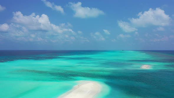 Beautiful fly over tourism shot of a sunshine white sandy paradise beach and turquoise sea