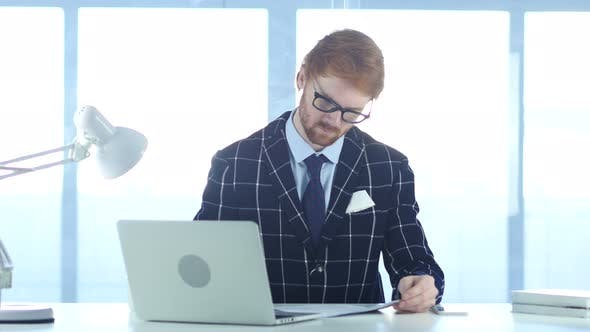 Thumbnail for Redhead Businessman Writing in Office, Documentation