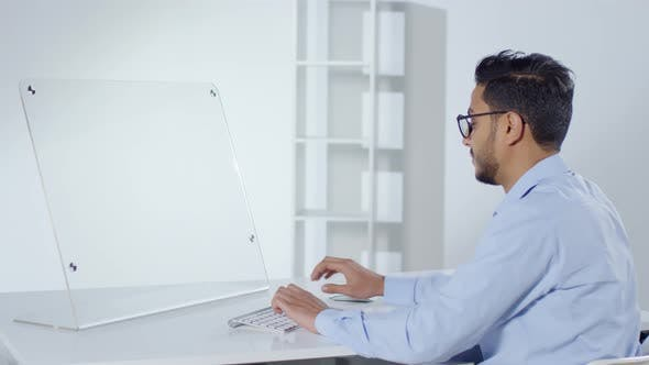Cover Image for Programmer Using Futuristic Computer in Office