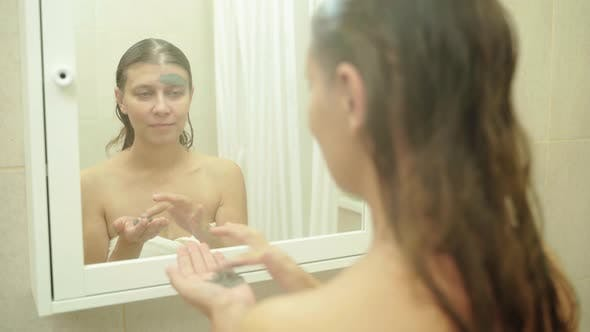 Funny Happy Attractive Woman Apply Skincare Cream On Face Mask