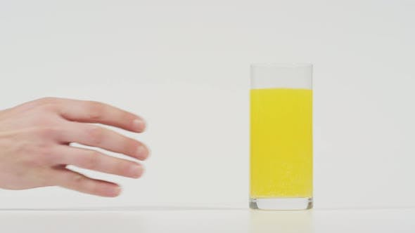 Thumbnail for Hand taking a glass of effervescent water