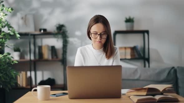 Woman in Eyewear Using Laptop for Studying