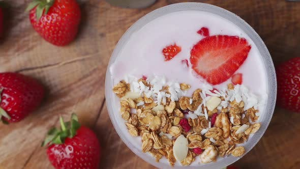 Rotating Breakfast with Yogurt, Granola, with Superfood Toppings, the View From the Top. Concept of
