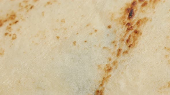 Thumbnail for Texture of pancake after being fried slow tilt close-up 4K 2160p 30fps UltraHD footage - Confection