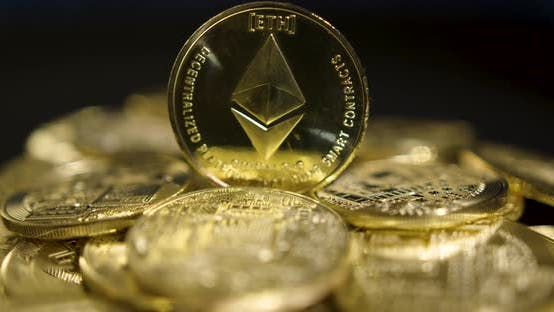 Thumbnail for Cryptocurrency Real Golden Coins With Ethereum Logo On Black Background
