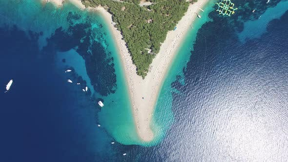 Thumbnail for Aerial view of people sunbathing on a sandy beach on the island of Brac, Croatia