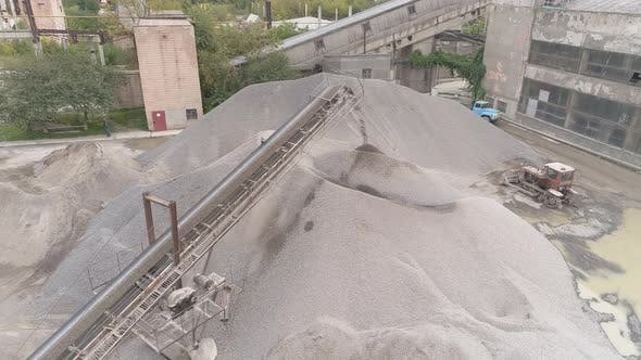 Thumbnail for Aerial shot of conveyor belts and sand heaps