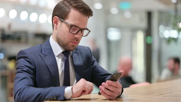Thumbnail for Attractive Businesswoman Using Smartphone at Work