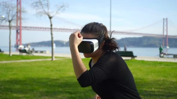Cover Image for Girl in Vr Headset Boxing Outdoor