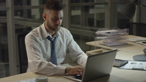 Thumbnail for Concentrated Businessman Typing on Laptop