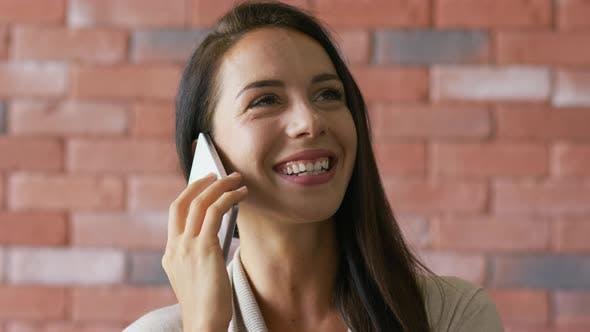 Elegant Brunette Speaking on Smartphone