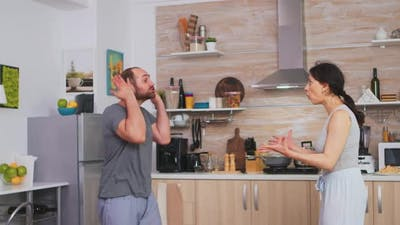 Aggressive Man Threating to Hit Wife
