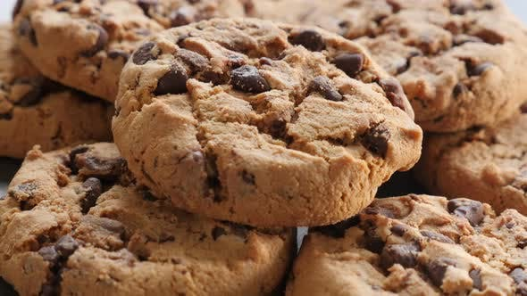 Thumbnail for Cookies on the wooden table slow tilting 4K 3840X2160 UltraHD footage - Slow tilt of chocolate cooki