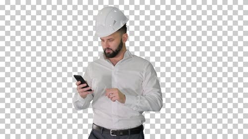 Engineer walking and using smartphone, Alpha Channel