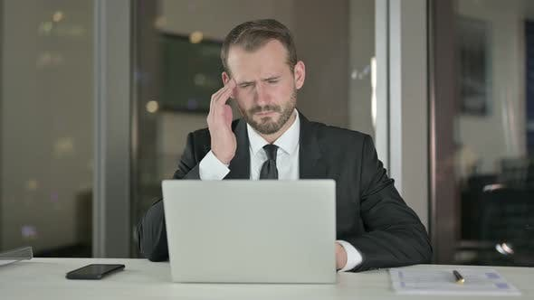 Thumbnail for Stressed Businessman Having Headache in Office at Night