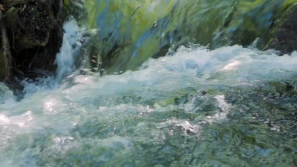 Small Waterfall Creates a Foam. .