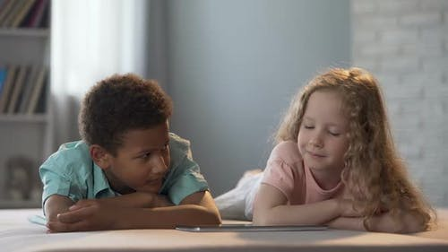 Children Watching Cognitive Show Hesitantly Looking at Each Other Embarrassing