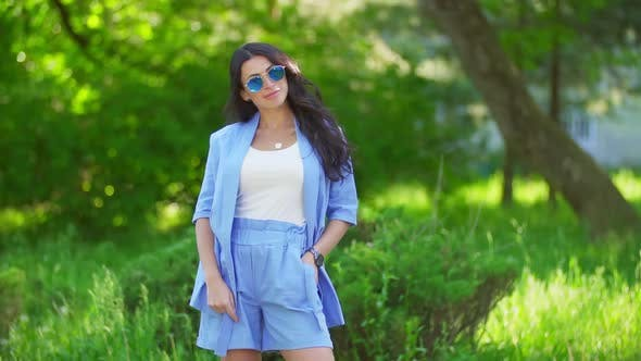Thumbnail for Woman in Blue Costumes and Sunglasses