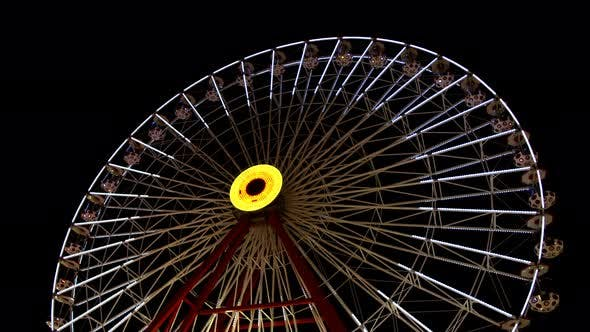 Ferris Wheel In Amusement Park At Night