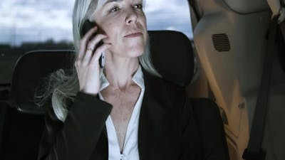 Vertical Motion of Woman Talking on Smartphone