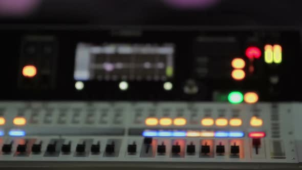 Thumbnail for Mixing Console with Lighting Buttons, Refocused Video of Audio Equipment