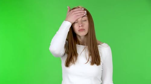 Portrait of Pretty Young Woman Is Upset and Making Facepalm.