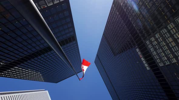 Thumbnail for Rotating Around Tall Office Buildings Downtown With Tall Canadian Flag In Daylight 2