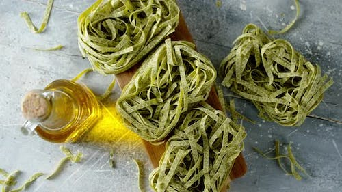 Dry Pasta Tagliatelle with Spinach Slowly Rotates.