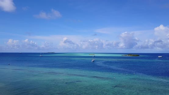 Thumbnail for Natural aerial island view of a white sandy paradise beach and blue water background in colorful 4K
