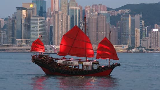 Thumbnail for Hong Kong city with red sailing boat on Victoria Harbor