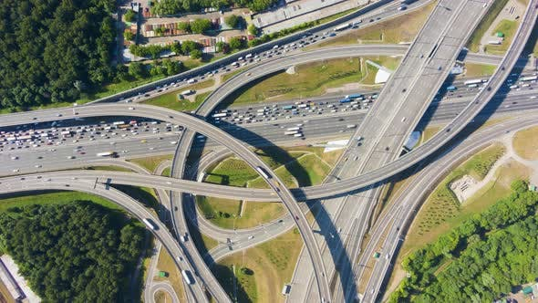 Road Junction and Cars Traffic in Summer Day. Flyover. Aerial Top-Down View