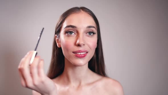 Girl Applying Eyeliner on Her Eyes