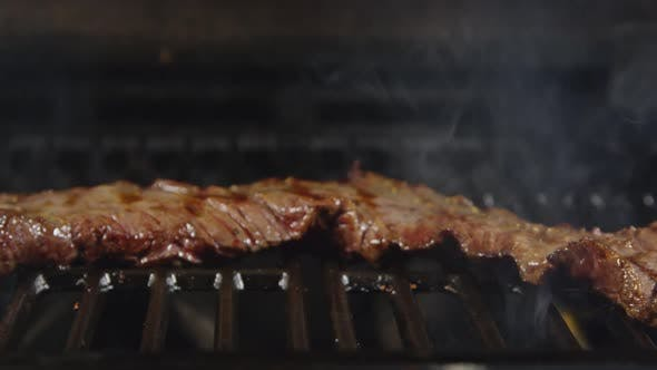 Cover Image for Skirt Steak Being Grilled With Flames 57