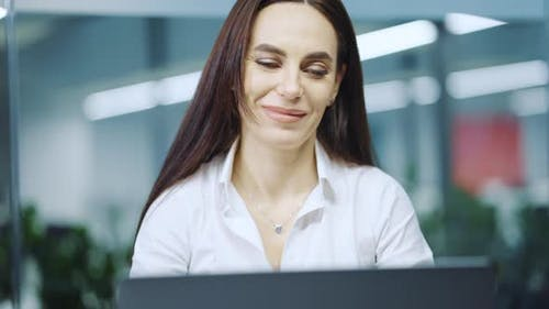 Woman Feeling Ecstatic at Receiving Mail on Laptop