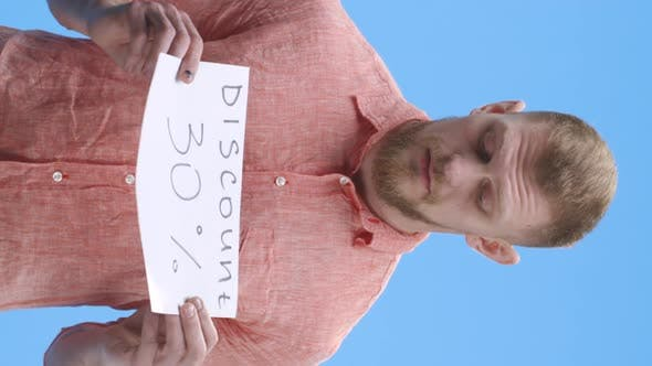 Thumbnail for Young Man Holding Discount Sign