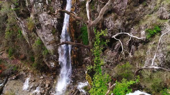 Thumbnail for Drone of Water Cascading Over Cliff
