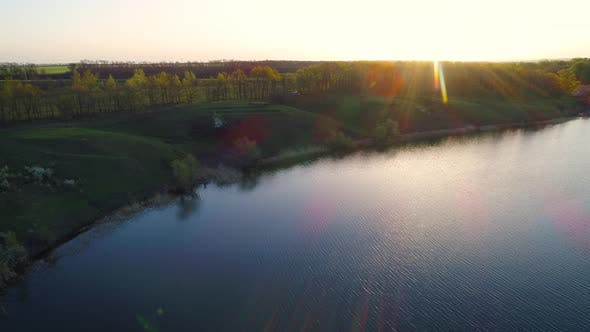 Flying Over the Beautiful Spring River. Aerial Camera Shot. Ukraine.