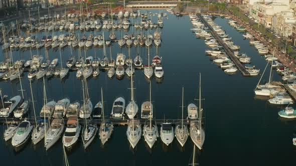 Sailboats in the Harbour of Small Town on Malta Island, Aerial Tilt Down View