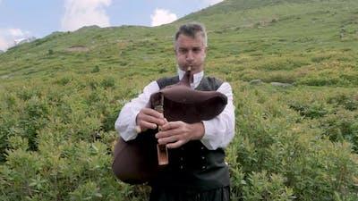 Man Playing Turkish Tulum