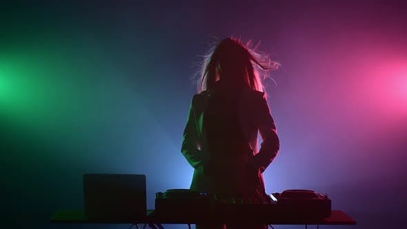 Thumbnail for Beautiful, Smiling, Sexy Dj Girl in White Jacket, Headphones Playing Music and Dancing, Puts Hand in