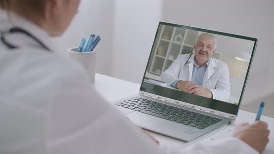 Thumbnail for Professor of Medicine Is Lecturing Online, Female Doctor Is Listening and Viewing at Display of