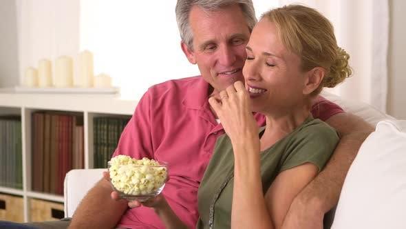Thumbnail for Senior couple eating popcorn