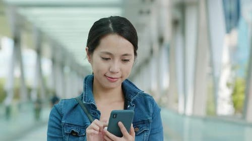 Woman look at smart phone in the buisness district