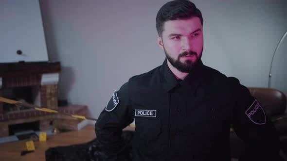 Thumbnail for Portrait of Handsome Caucasian Bearded Police Officer Standing at the Crime Scene and Thinking