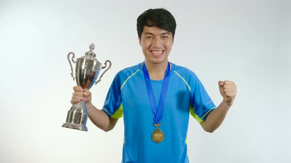 Man Celebrating With Trophy