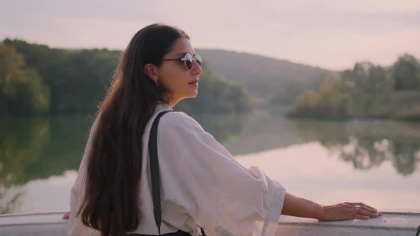 Woman Contemplating Nature at Sunset