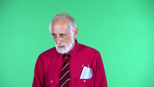 Thumbnail for Portrait of Happy Old Aged Man 70s Communicates with Someone, Isolated Over Green Background.