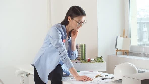 Professional Designer Enjoying Her Work in Office with Modern Interior