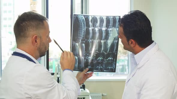 Thumbnail for Experienced Doctors Are Studying the X-Ray of Their Patient