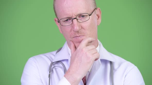 Cover Image for Serious Mature Bald Man Doctor Thinking